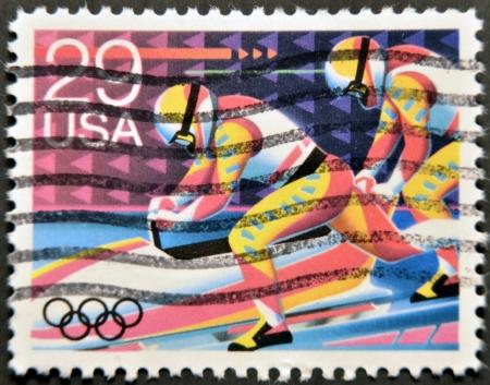 UNITED STATES OF AMERICA - CIRCA 1992: A stamp printed in USA dedicated to Winter Olympics, shows bob-sledding, circa 1992 Stock Photo - 12207349