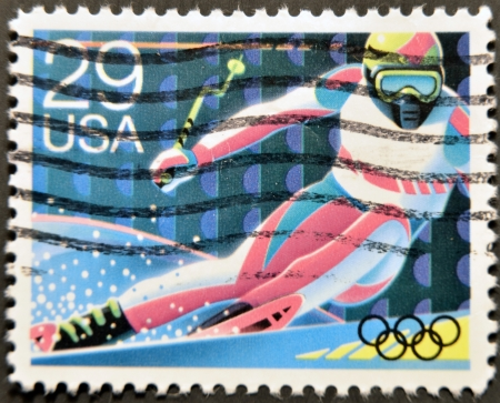 UNITED STATES OF AMERICA - CIRCA 1992: A stamp printed in USA dedicated to Winter Olympics, shows a man skiing, circa 1992 Stock Photo - 12207358