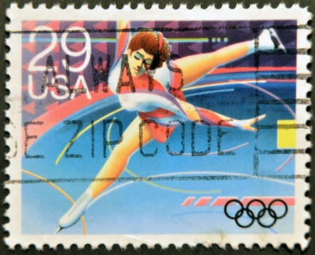 UNITED STATES OF AMERICA - CIRCA 1992: A stamp printed in USA dedicated to Winter Olympics, shows figure skating, circa 1992 Stock Photo - 12207357