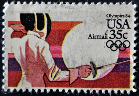 swordsmanship: USA - CIRCA 1984 : A stamp printed in the USA dedicated to Olympics 84, fencing, circa 1984