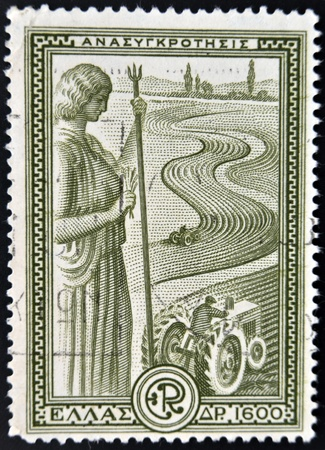 fertility goddess: GREECE - CIRCA 1970: A stamp printed in Greece shows statue of Ceres overlooking an agricultural field, circa 1970  Stock Photo