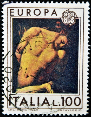 flagellation: ITALY - CIRCA 1975: A stamp printed in Italy shows the flagellation of Christ by Caravaggio, circa 1975