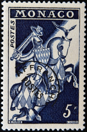MONACO - CIRCA 1960: A stamp printed in Monaco shows Knight in Armor, circa 1960 photo