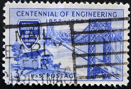 UNITED STATES - CIRCA 1952: A  stamp printed in USA shows George Washington Bridge and Covered Bridge of 1850s, Engineering Centennial Issue, circa 1952  photo