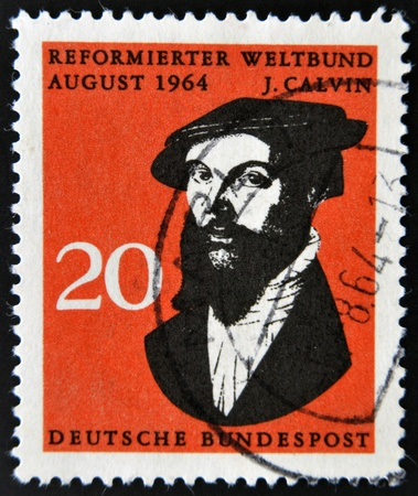 theologian: GERMANY -CIRCA 1964: A stamp printed in Germany shows John Calvin, influential French theologian and pastor during the Protestant Reformation, circa 1964.