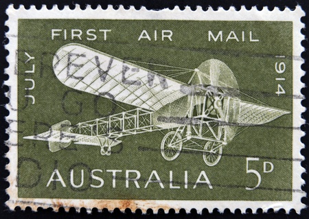 monoplane: AUSTRALIA - CIRCA 1964: A stamp printed in Australia shows a Bleriot monoplane  printed to commemorate the 50th anniversary of the first air mail flight in Australia, circa 1964.