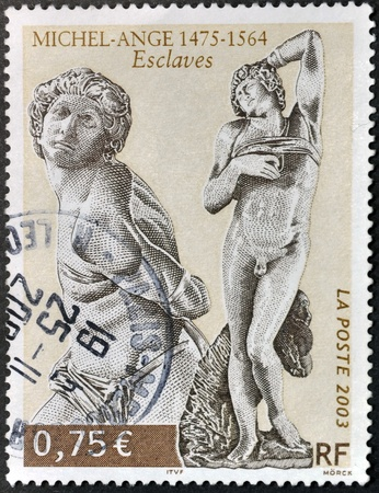 slaves: FRANCE - CIRCA 2003: A stamp printed in France shows Slaves sculptures by Michelangelo, circa 2003 Editorial
