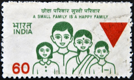 INDIA - CIRCA 1980: A stamp printed in India shows A small family is a happy family, circa 1980  photo