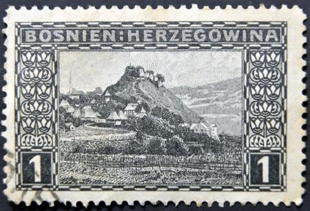 bosnia and hercegovina: BOSNIA AND HERCEGOVINA - CIRCA 1906: A stamp printed in Bosnia and Hercegovina shows Doboj, a village in mountains, circa 1906 Stock Photo