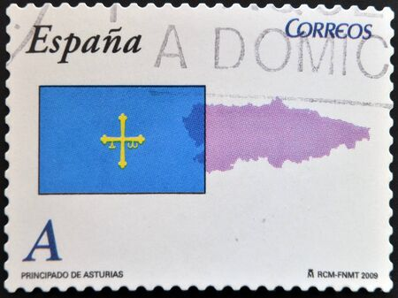 SPAIN - CIRCA 2009: A stamp printed in spain shows flag and map of the autonomous community of Asturias, circa 2009 photo