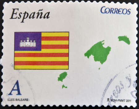 SPAIN - CIRCA 2011: A stamp printed in spain shows flag and map of the autonomous community of balearic islands, circa 2011 photo