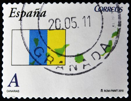 SPAIN - CIRCA 2010: A stamp printed in spain shows flag and map of the autonomous community of canary islands, circa 2010 photo