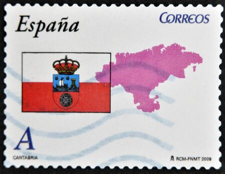 SPAIN - CIRCA 2009: A stamp printed in spain shows flag and map of the autonomous community of Cantabria, circa 2009 photo