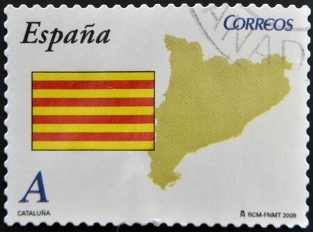 SPAIN - CIRCA 2009: A stamp printed in spain shows flag and map of the autonomous community of Catalonia, circa 2009 photo