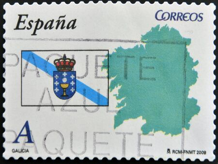 SPAIN - CIRCA 2009: A stamp printed in spain shows flag and map of the autonomous community of Galicia, circa 2009 photo