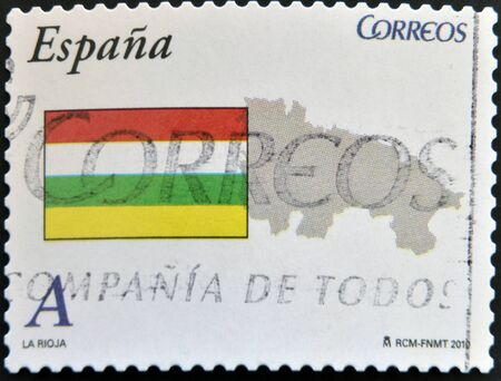 SPAIN - CIRCA 2010: A stamp printed in spain shows flag and map of the autonomous community of La Rioja, circa 2010 photo