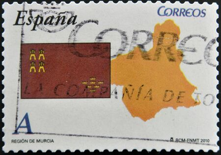 SPAIN - CIRCA 2010: A stamp printed in spain shows flag and map of the autonomous community of Murcia, circa 2010 photo
