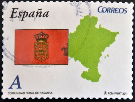 SPAIN - CIRCA 2011: A stamp printed in spain shows flag and map of the autonomous community of Navarra, circa 2011 photo