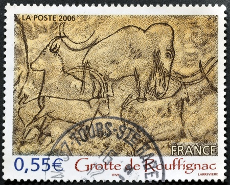 cavern: FRANCE - CIRCA 2006: A stamp printed in France shows prehistoric paintings in the Grotte de Rouffignac, circa 2006
