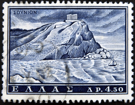GREECE - CIRCA 1961: A stamp printed in Greece from the Landscapes and Ancient monuments issue showing the Poseidon temple at Sounio, circa 1961.  photo