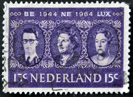postmark: HOLLAND - CIRCA 1964: a stamp printed in the Netherlands shows King Baudouin, Queen Juliana and Grand Duchess Charlotte, Benelux, circa 1964