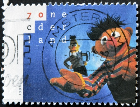 comic duo: HOLLAND - CIRCA 1996: A stamp printed in Netherlands shows Bert and Ernie, circa 1996