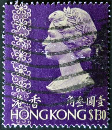 HONG KONG - CIRCA 1973: A stamp printed in Hong Kong showing a portrait of Queen Elizabeth II, circa 1973.