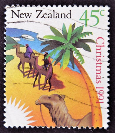 NEW ZEALAND - CIRCA 1991: A stamp printed in New Zealand shows Men on camels, circa 1991 Stock Photo - 12207509