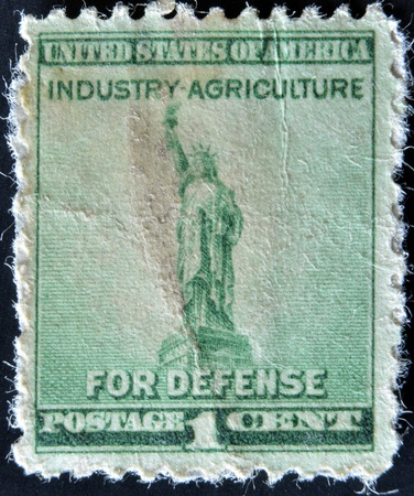 USA - CIRCA 1940: A Stamp printed in USA shows the Statue of Liberty, with the inscription Idustry - Agriculture for Defense, circa 1940  photo