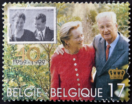 motril: BELGIUM - CIRCA 1999: A stamp printed in Belgium shows the kings, Baudouin I and Fabiola, circa 1999 Editorial