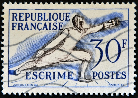FRANCE - CIRCA 1953: A stamp printed in France devoted to fencing, circa 1953