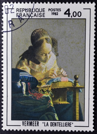 FRANCE - CIRCA 1982: A stamp printed in France  shows painting of Johan Vermeer - The Lacemaker, circa 1982