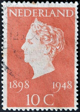 wilhelmina: HOLLAND - CIRCA 1948: A stamp printed in Netherlands shows queen Wilhelmina, circa 1948 Editorial