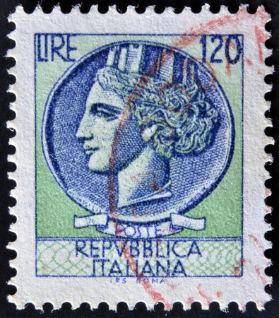 ITALY - CIRCA 1968: A stamp printed in Italy, is shown Italia Turrita after Syracusean Coin, circa 1968  Stock Photo - 12445474