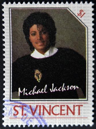 michael jackson: ST. VINCENT - CIRCA 1985: A stamp printed in St. Vincent shows Michael Jackson, circa 1985