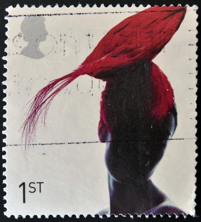 UNITED KINGDOM - CIRCA 2001: A stamp printed in Great Britain dedicated to fabulous hats,  shows Toque Hat by Pip Hackett, circa 2001  Stock Photo - 12445462