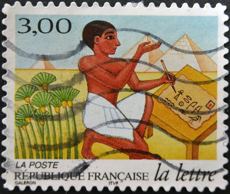 scribe: FRANCE - CIRCA 1998: A stamp printed in France shows Egyptian scribe, circa 1998 Editorial