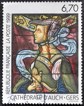 FRANCE - CIRCA 1999: A stamp printed in France shows Window of the Cathedral of Auch, circa 1999