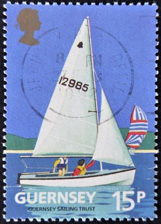 guernsey: GUERNSEY - CIRCA 1992: A stamp printd in Guernsey shows a sailboat, circa 1992