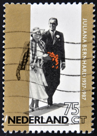 juliana: HOLLAND -CIRCA 1987: Stamp printed in the Netherlands for the golden jubilee of the wedding of Queen Juliana with Prince Bernhard von Lippe Biesterfeld in 1937, circa 1987
