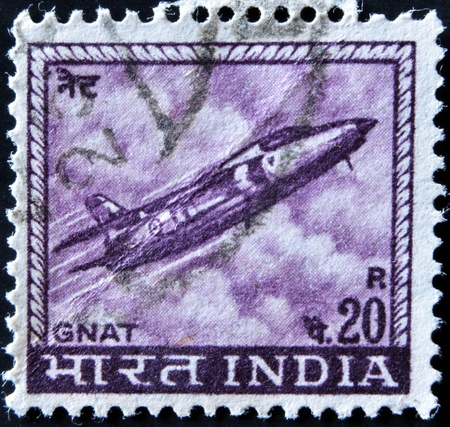 gnat: INDIA - CIRCA 1967: A stamp printed in India shows a Folland Gnat fighter jet from the Indian Airforce, circa 1967.