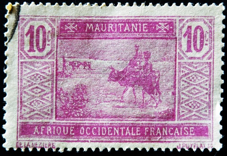 MAURITANIA - CIRCA 1922: stamp printed by Mauritania shows Bedouins and animals, circa 1922