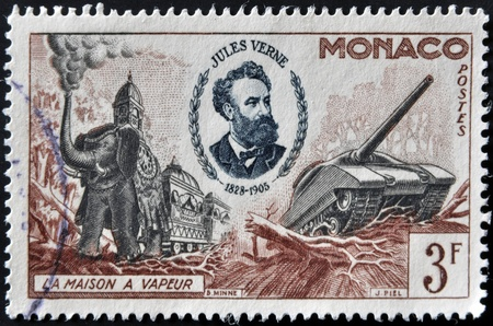 MONACO - CIRCA 1955: A stamp printed in Monaco shows Portrait of Jules Verne and illustration of his work with inscription Steam House ,circa 1955