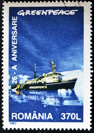 greenpeace: ROMANIA - CIRCA 1997: A stamp printed by Romania dedicated to Greenpeace, circa 1997