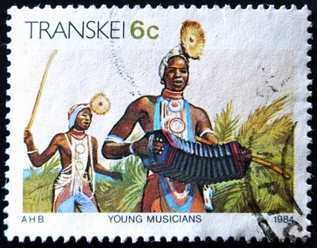 rsa: REPUBLIC OF SOUTH AFRICA - CIRCA 1984: A stamp printed in Transkei shows young musicians, circa 1984