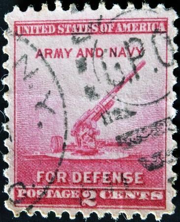 postmaster: UNITED STATES OF AMERICA - CIRCA 1940: a stamp printed in the United States of America shows 90-millimeter Anti-aircraft Gun, circa 1940  Editorial