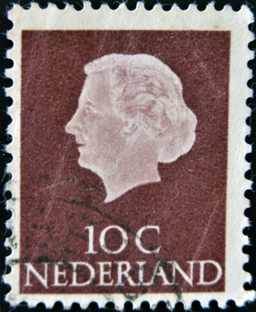 HOLLAND - CIRCA 1964  A stamp printed in the Netherlands shows image of Queen Juliana, circa 1964