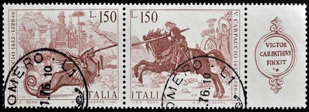 slaying: ITALY - CIRCA 1976  A stamp printed in Italy shows St  George slaying the dragon by Vittore Carpaccio, circa 1976