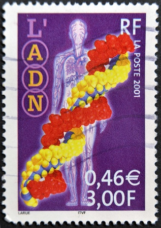 genom: FRANCE - CIRCA 2001: A stamp printed in France shows DNA, circa 2001  Editorial