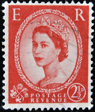cancelled stamp: UNITED KINGDOM - CIRCA 1952  A  stamp printed in Great Britain showing a portrait of queen Elizabeth II, circa 1952   Editorial